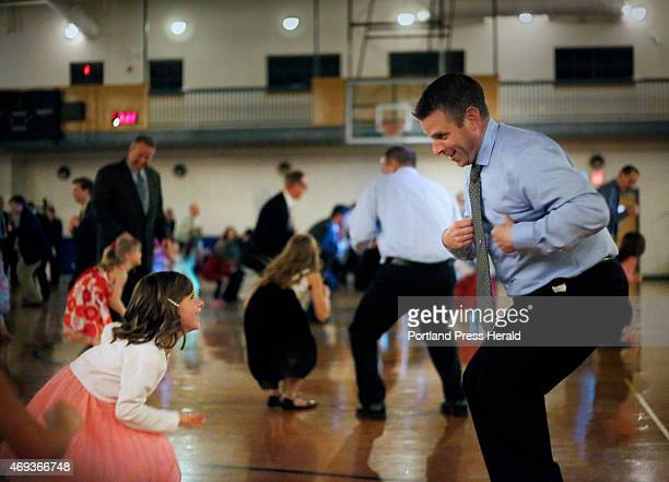 Scott Corbett and his daughter Nia at the father/daughter dance in South Portland
