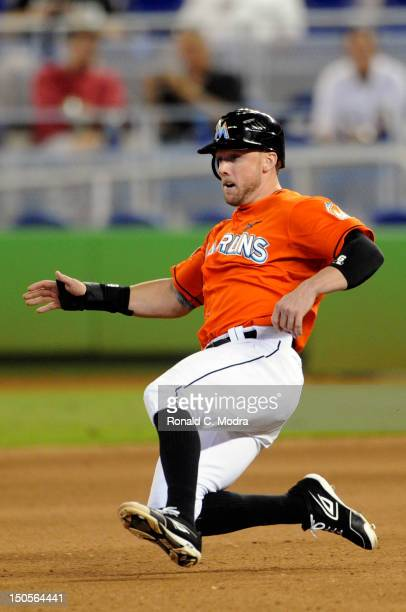 Scott Cousins of the Miami Marlins slides into second base during an MLB game against the Philadelphia Phillies at Marlins Park on August 15 2012 in...