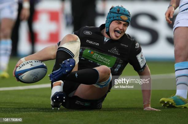 Scott Cummings of Glasgow Warriors celebrates after scoring his team's second try during the Champions Cup match between Glasgow Warriors and Cardiff...