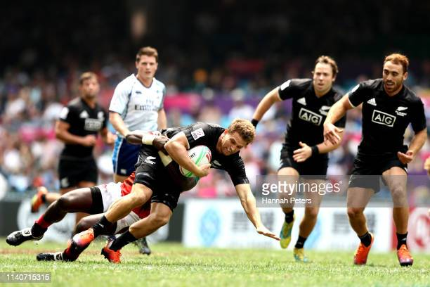 Scott Curry of New Zealand charges forward against Kenya on day two of the Cathay Pacific/HSBC Hong Kong Sevens at the Hong Kong Stadium on April 06...