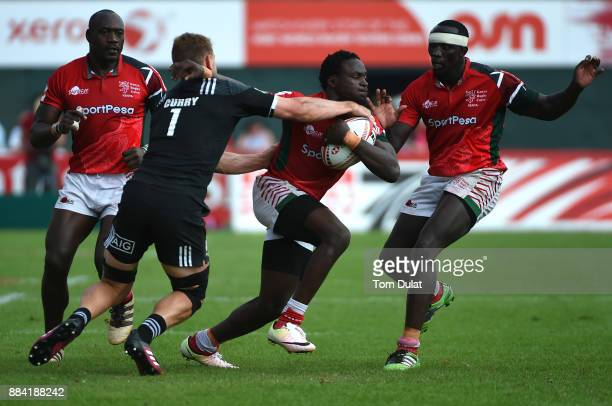 Scott Curry of New Zealand tackles Nelson Oyoo of Kenya during the Cup Quarter Final match between New Zealand and Kenya on Day Three of the Emirates...