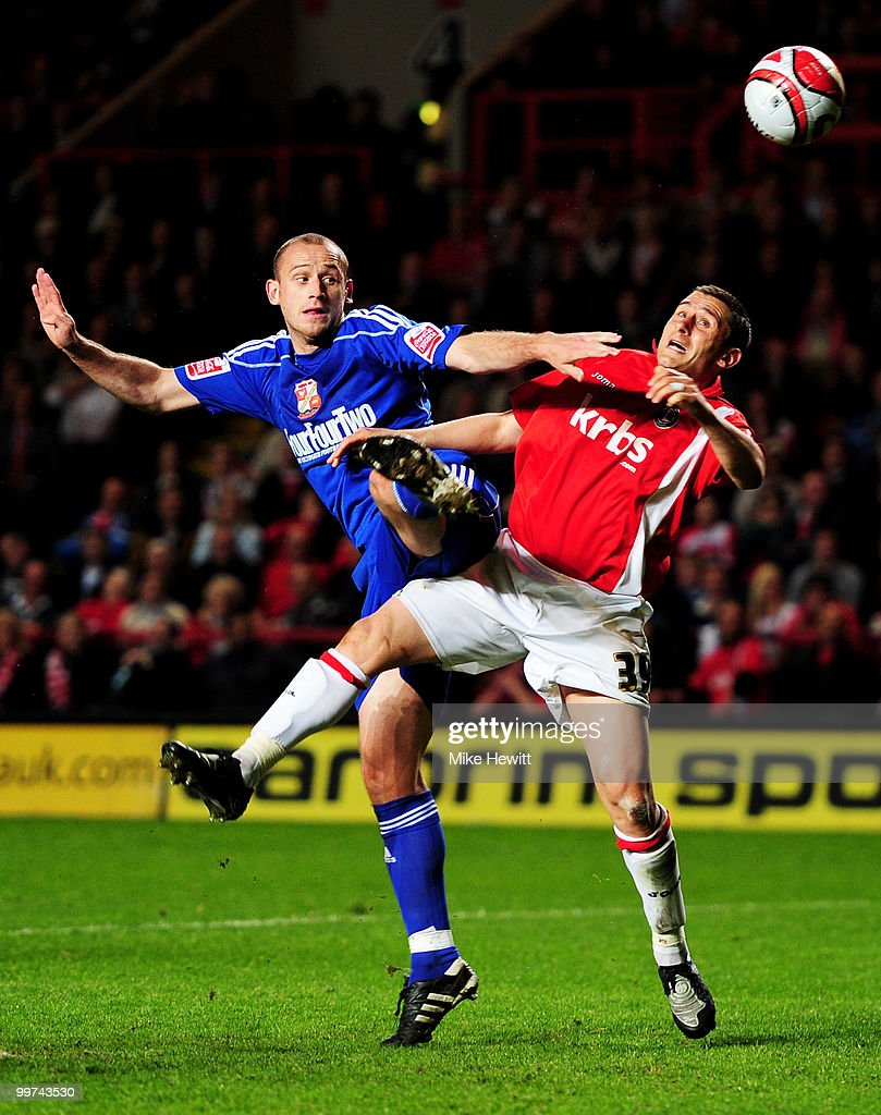 Scott Cuthbert of Swindon challenges Nicky Forster of Charlton during the Coca-Cola League One Playoff Semi Final 2nd Leg between Charlton Athletic and Swindon Town at The Valley on May 17, 2010 in London, England.