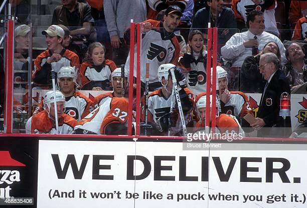 Scott Daniels, Eric Desjardins, Rod Brind'Amour, Trent Klatt, Karl Dykhuis, Daniel Lacroix and Mikael Renberg of the Philadelphia Flyers sit in the...