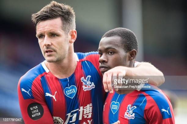 Scott Dann and Tyrick Mitchell of Crystal Palace reaction on pitch after the Premier League match between Crystal Palace and Tottenham Hotspur at...