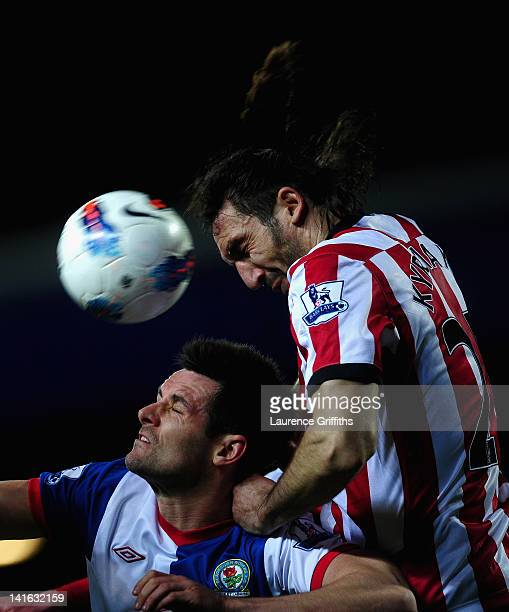 Scott Dann of Blackburn Rovers battles with Sotirios Kyrgiakos of Sunderland during the Barclays Premier League match between Blackburn Rovers and...