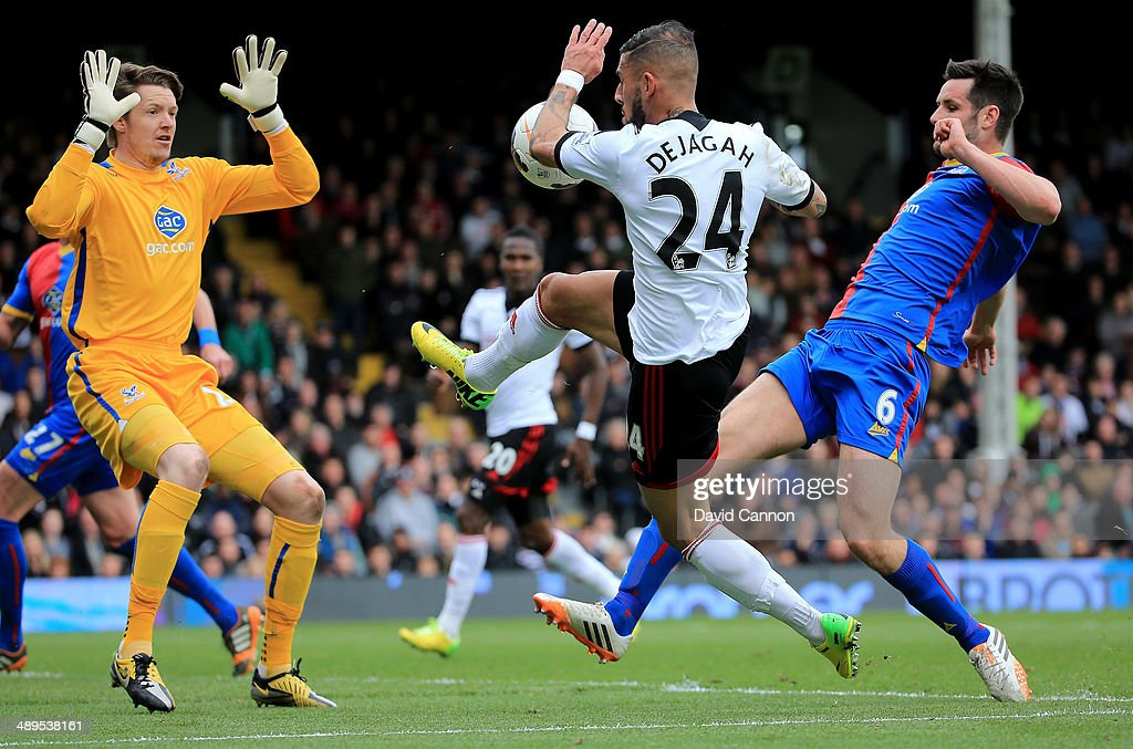 Scott Dann of Crystal Palace and Ashkan Dejagah of Fulham clash as Wayne Hennessey the Palace goalkeeper waits to pounce during the Barclays Premier League match between Fulham and Crystal Palace at Craven Cottage on May 11, 2014 in London, England.