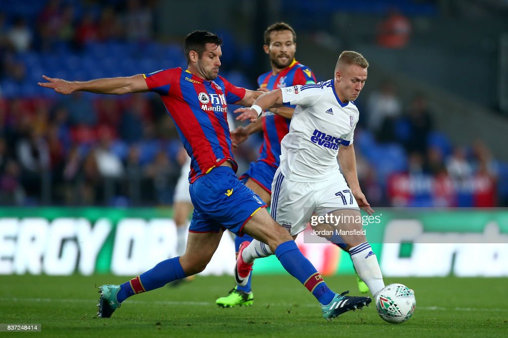 Scott Dann of Crystal Palace and Danny Martin Rowe of Ipswich battle for possession during the Carabao Cup Second Round match between Crystal Palace and Ipswich Town at Selhurst Park on August 22, 2017 in London, England.