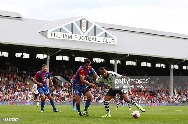 Scott Dann of Crystal Palace and Konstantinos Mitroglou of Fulham in action during the preseason friendly between Fulham and Watford at Craven...