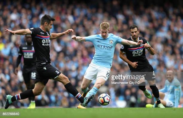 Scott Dann of Crystal Palace attempts to tackle Kevin De Bruyne of Manchester City during the Premier League match between Manchester City and...