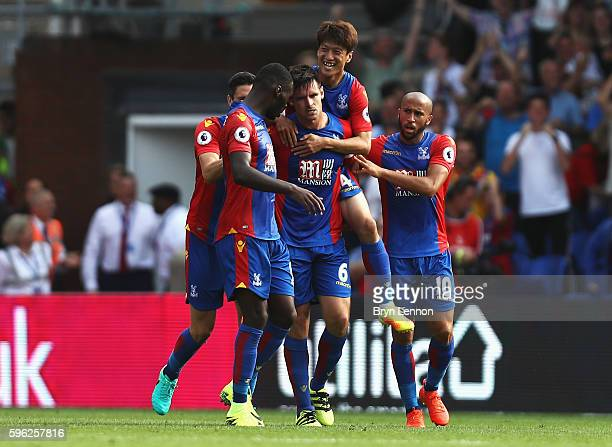 Scott Dann of Crystal Palace celebrates scoring his sides first goal with his team mates during the Premier League match between Crystal Palace and...