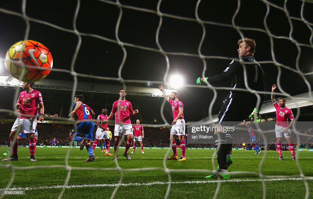 Scott Dann (2nd L) of Crystal Palace celebrates scoring his team's first goal past Artur Boruc of Bournemouth during the Barclays Premier League match between Crystal Palace and A.F.C. Bournemouth at Selhurst Park on February 2, 2016 in London, England.