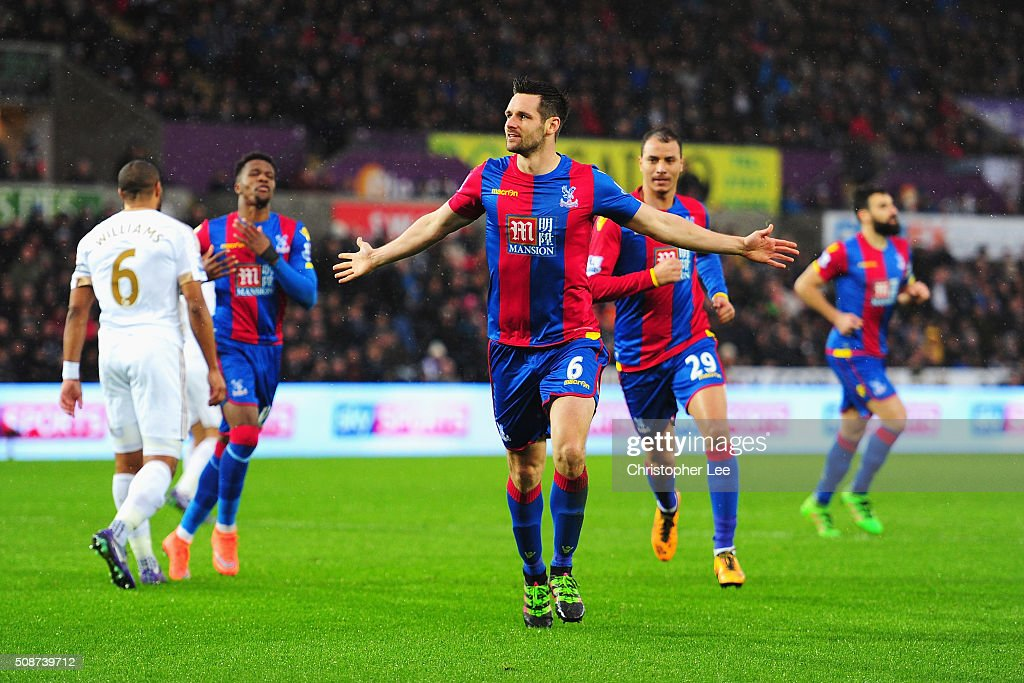 Scott Dann of Crystal Palace celebrates scoring his team's first goal during the Barclays Premier League match between Swansea City and Crystal Palace at the Liberty Stadium on February 6, 2016 in Swansea, Wales.