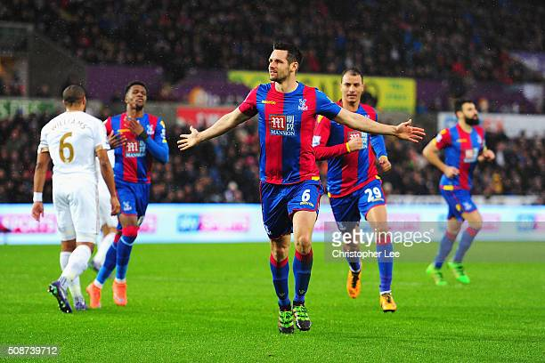 Scott Dann of Crystal Palace celebrates scoring his team's first goal during the Barclays Premier League match between Swansea City and Crystal...