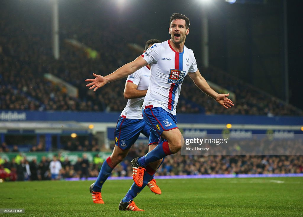 Scott Dann of Crystal Palace celebrates scoring the opening goal during the Barclays Premier League match between Everton and Crystal Palace at Goodison Park on December 7, 2015 in Liverpool, England.