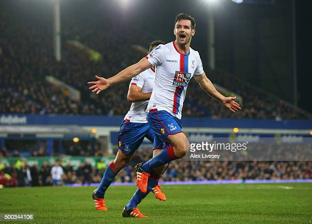 Scott Dann of Crystal Palace celebrates scoring the opening goal during the Barclays Premier League match between Everton and Crystal Palace at...