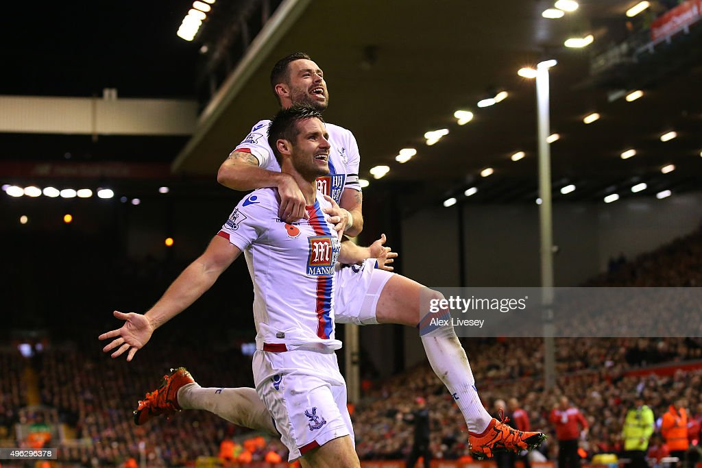 Scott Dann of Crystal Palace (L) celebrates with Damien Delaney of Crystal Palace after scoring his side's second goal during the Barclays Premier League match between Liverpool and Crystal Palace at Anfield on November 8, 2015 in Liverpool, England.