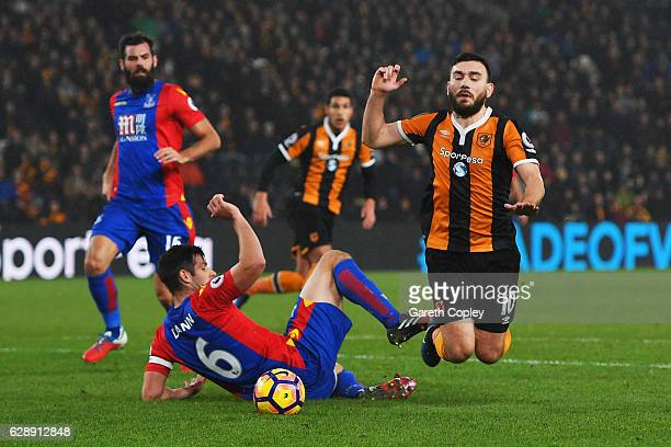 Scott Dann of Crystal Palace challenges Robert Snodgrass of Hull City to concede a penalty during the Premier League match between Hull City and...