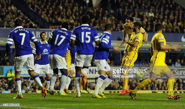 Scott Dann of Crystal Palace heads his side's second goal during the Barclays Premier League match between Everton and Crystal Palace at Goodison...
