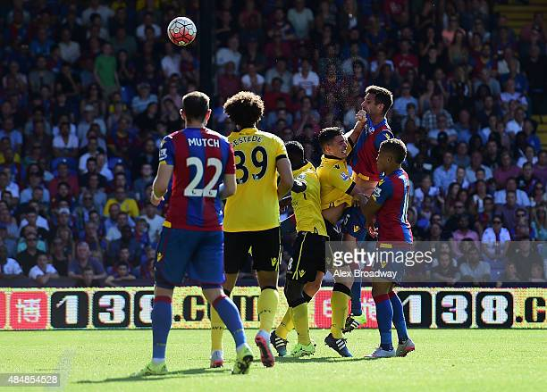 Scott Dann of Crystal Palace heads to score his team's first goal during the Barclays Premier League match between Crystal Palace and Aston Villa at...
