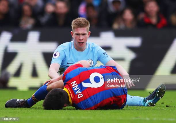 Scott Dann of Crystal Palace is injured as Kevin De Bruyne of Manchester City looks on during the Premier League match between Crystal Palace and...