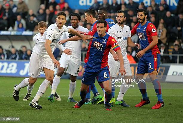 Scott Dann of Crystal Palace pushes back Federico Fernandez of Swansea City and other players during the Premier League match between Swansea City...