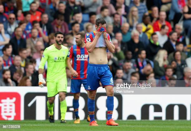 Scott Dann of Crystal Palace reacts during the Premier League match between Crystal Palace and Chelsea at Selhurst Park on October 14 2017 in London...