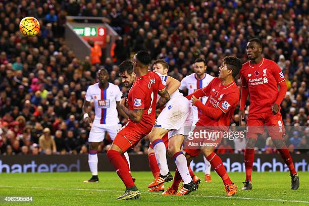 Scott Dann of Crystal Palace scores his side's second goal during the Barclays Premier League match between Liverpool and Crystal Palace at Anfield...