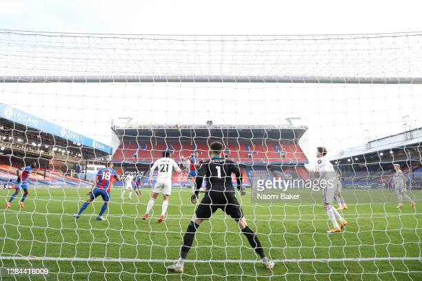 Scott Dann of Crystal Palace scores his team's first goal past Illan Meslier of Leeds United during the Premier League match between Crystal Palace...