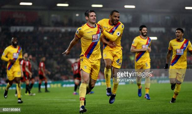 Scott Dann of Crystal Palace scores the opening goal with his team mate Jason Puncheon during the Premier League match between AFC Bournemouth and...
