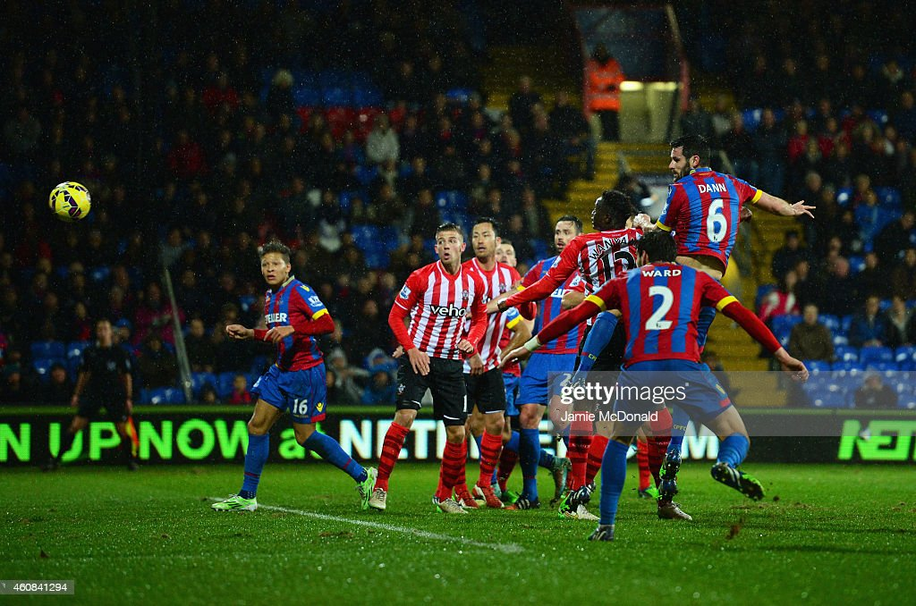 Scott Dann of Crystal Palace (6) scores their first goal with a header during the Barclays Premier League match between Crystal Palace and Southampton at Selhurst Park on December 26, 2014 in London, England.