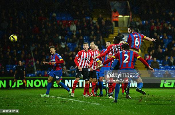 Scott Dann of Crystal Palace scores their first goal with a header during the Barclays Premier League match between Crystal Palace and Southampton at...