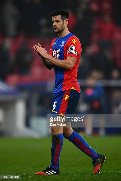 Scott Dann of Crystal Palace shows appreciation to the fans after the final whistle during the Premier League match between Crystal Palace and...
