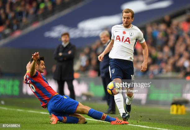 Scott Dann of Crystal Palace tackles Harry Kane of Tottenham Hotspur during the Premier League match between Tottenham Hotspur and Crystal Palace at...
