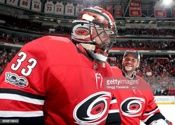 Scott Darling and Cam Ward of the Carolina Hurricanes celebrate their team's opening night 54 victory over the Minnesota Wild following an NHL game...