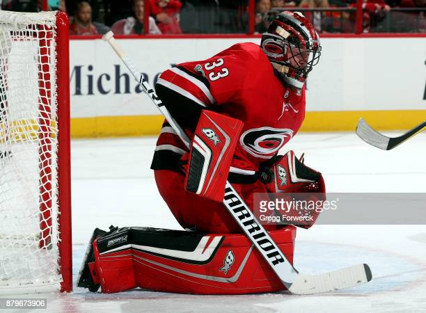 Scott Darling of the Carolina Hurricanes bodies down a Nashville Predators shot during an NHL game on November 26 2017 at PNC Arena in Raleigh North...