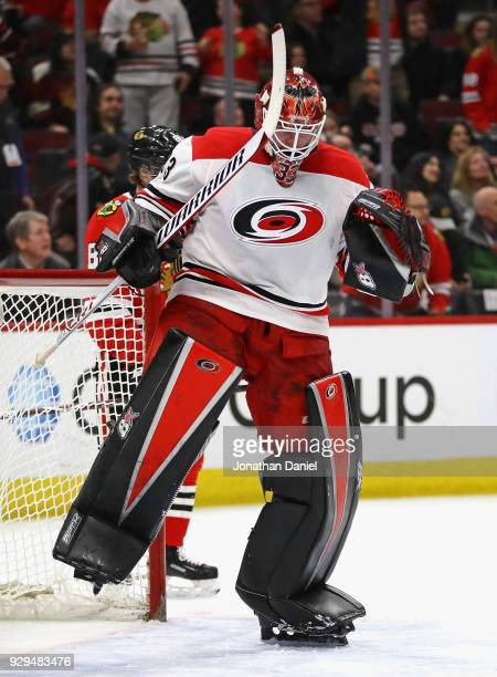 Scott Darling of the Carolina Hurricanes celebrates after a win against the Chicago Blackhawks at the United Center on March 8 2018 in Chicago...