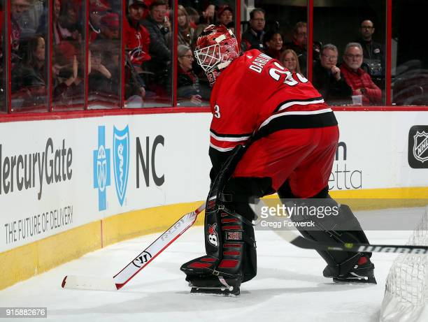 Scott Darling of the Carolina Hurricanes plays the puck behind the net during an NHL game against the Detroit Red Wings on February 2 2018 at PNC...