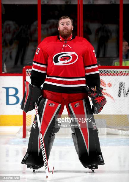 Scott Darling of the Carolina Hurricanes stands tall near the crease during the national anthem prior to an NHL game against the Calgary Flames on...