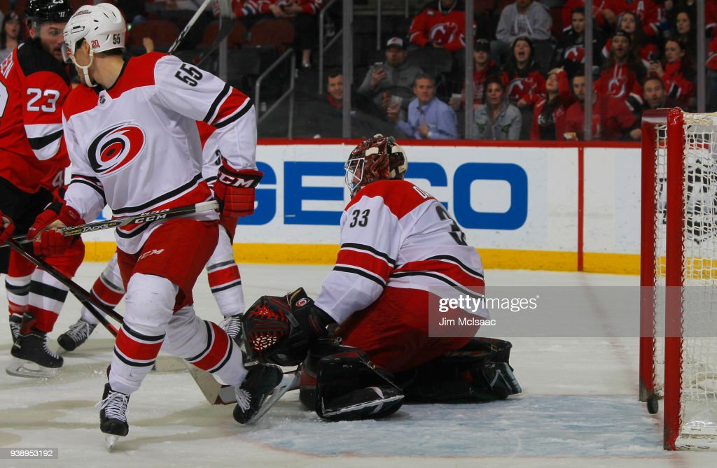 Scott Darling #33 of the Carolina Hurricanes surrenders a goal to Stefan Noesen #23 of the New Jersey Devils in the third period for the game winner on March 27, 2018 at Prudential Center in Newark, New Jersey.
