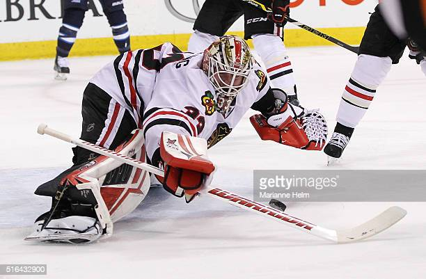 Scott Darling of the Chicago Blackhawks blocks a shot on goal in secondperiod action in an NHL game against the Winnipeg Jets at the MTS Centre on...