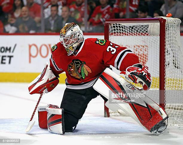 Scott Darling of the Chicago Blackhawks follows the action against the Arizona Coyotes at the United Center on April 5 2016 in Chicago Illinois The...