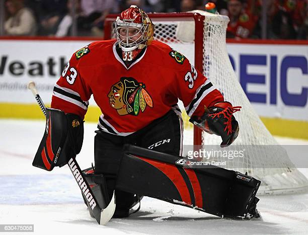 Scott Darling of the Chicago Blackhawks follows the action against the Ottawa Senators at the United Center on December 20 2016 in Chicago Illinois