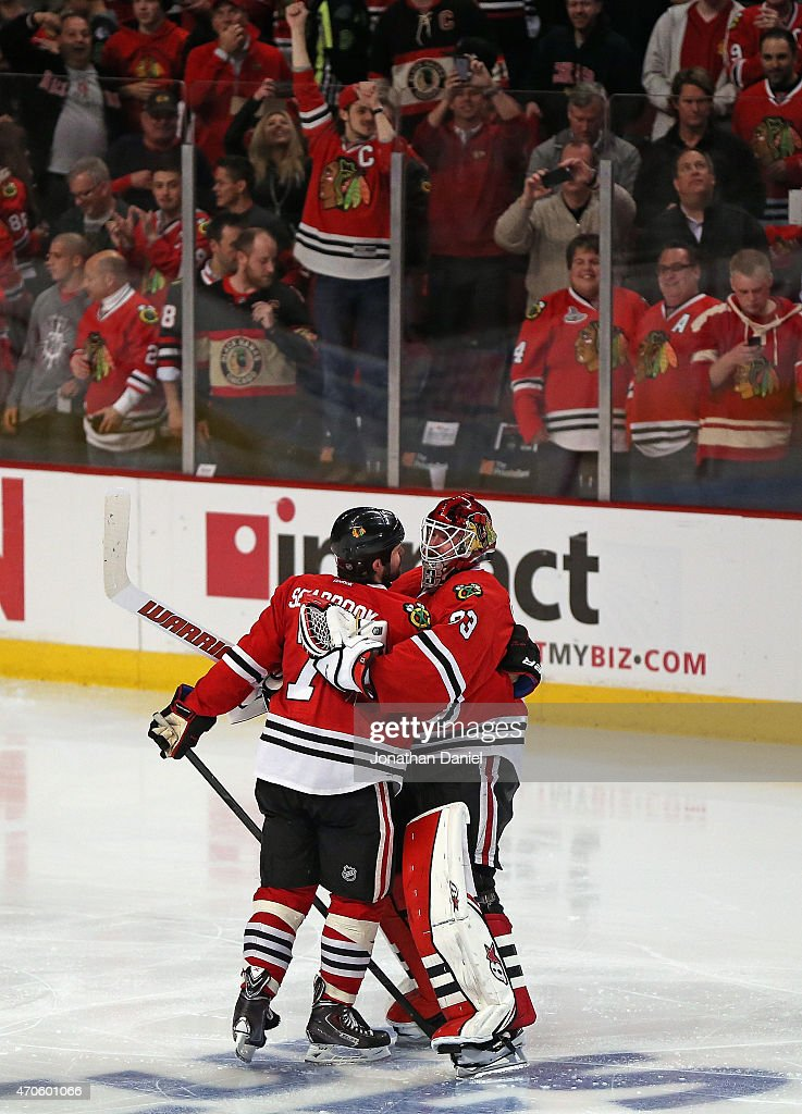 Scott Darling #33 of the Chicago Blackhawks (R) hugs teammate Brent Seabrook #7 after Seabrook scored the game winning goal in triple overtime against the Nashville Predators in Game Four of the Western Conference Quarterfinals during the 2015 NHL Stanley Cup Playoffs at the United Center on April 21, 2015 in Chicago, Illinois. The Blackhawks defeated the Predators 3-2 in the third overtime.
