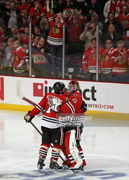 Scott Darling of the Chicago Blackhawks hugs teammate Brent Seabrook after Seabrook scored the game winning goal in triple overtime against the...
