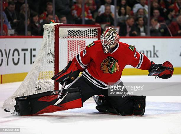 Scott Darling of the Chicago Blackhawks kicks the puck away for a save against the Toronto Maple Leafs at the United Center on February 15 2016 in...