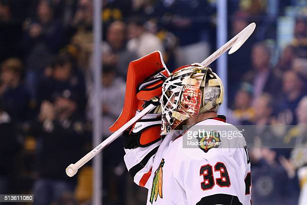 Scott Darling of the Chicago Blackhawks reacts after allowing a goal during the first period against the Boston Bruins at TD Garden on March 3 2016...