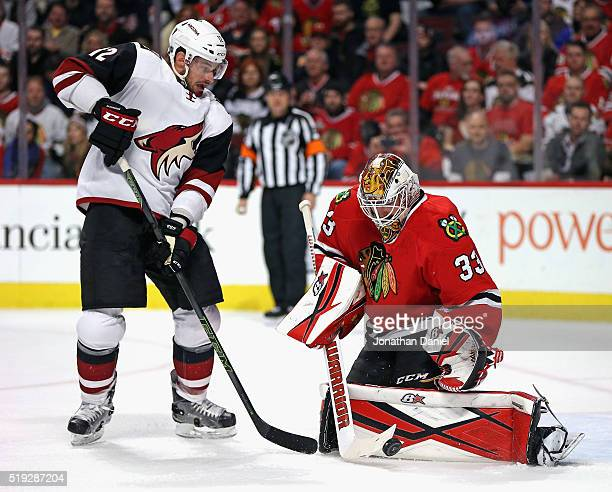 Scott Darling of the Chicago Blackhawks stops a shot by Brad Richardson of the Arizona Coyotes at the United Center on April 5 2016 in Chicago...