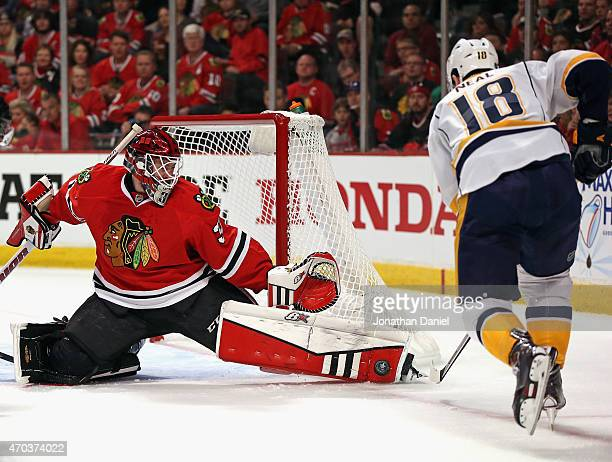 Scott Darling of the Chicago Blackhawks stops a shot by James Neal of the Nashville Predators in Game Three of the Western Conference Quarterfinals...