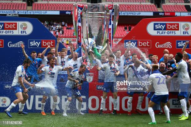 Scott Davies of Tranmere Rovers and Stephen McNulty of Tranmere Rovers lift the Sky Bet League Two Playoff Final Trophy following their victory in...