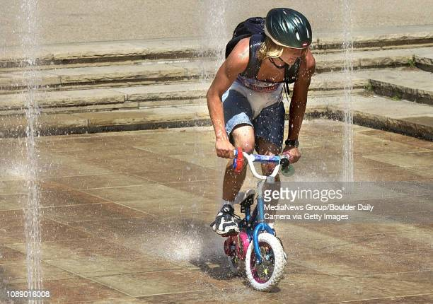 Scott DeVelder a University of Colorado sophomore rides a toddler bike through the newly renovated Dalton Trumbo water fountain at the University...